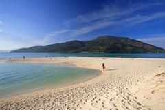 tropical beach against blue sky at koh lipe - stock photo