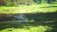 Exhalation above sewage well at summer day Stock Footage