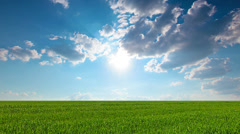 green field and cloudy sky. 4K. FULL HD, 4096x2304. - stock footage