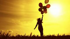 Woman Running With Balloons Slow Motion Happiness Concept Stock Footage