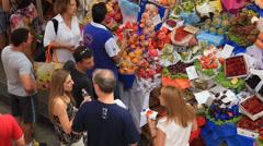 Consumers taste a fresh Mango at Municipal Market in Sao Paulo Stock Footage