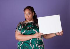 Stock Photo of Black woman holding a sign
