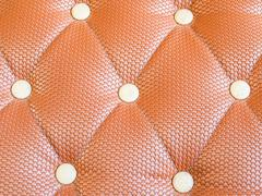 Brown upholstery leather pattern background Stock Photos
