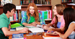 Students revising together in the library Stock Footage