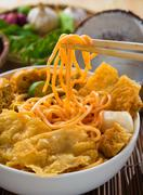 Curry laksa which is a popular traditional spicy noodle soup from the peranak Stock Photos