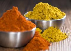 Curry and paprika powder Stock Photos