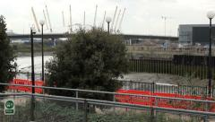 Tube train pulling out of station millennium dome Stock Footage