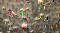 Indoor Rock Climbing Wall with marked climbs Stock Footage