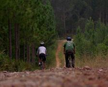 Two people mountain biking in Storms River, Port Elizabeth Stock Footage