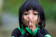filipina little girl praying - stock photo
