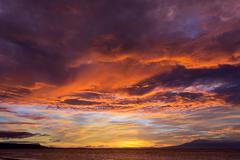 dramatic fiery orange sunset in siquijor - stock photo