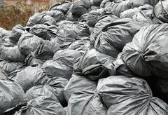 construction garbage bags in dumpster - stock photo