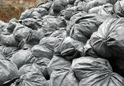 Stock Photo of construction garbage bags in dumpster
