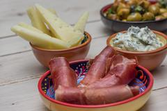 Tapas, cured ham, tzatziki and manchego Stock Photos
