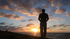 Man watching sunrise Stock Footage