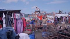 Rebuilding in refugee camp Jib shot - stock footage