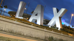 Stock Video Footage of Time lapse LAX sign dusk traffic International Airport Los Angeles USA