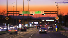 Car driving Rush-hour Traffic in city time lapse night - stock footage