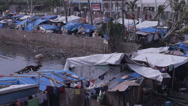 Stock Video Footage of Typhoon Haiyan Refugee camp pan