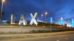 Time lapse LAX sign zoom dusk traffic International Airport Los Angeles USA - stock footage