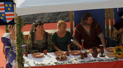 Elite sitting at king's table full of goodies - stock footage