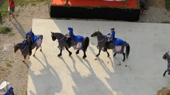 Cavalry with blue flags walks in half circle Stock Footage