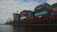 Cargo container ship waiting for departure Stock Footage