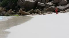 Walking on the exotic beach Stock Footage