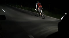 Following a cyclist in the dark Stock Footage