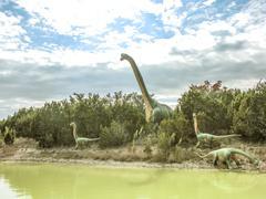Diasaurs by lake Stock Photos