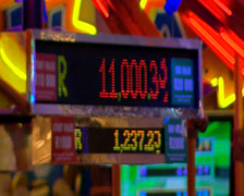 A slot machine grand prize total rising, lights flash behind it. The Boardwalk C Stock Footage