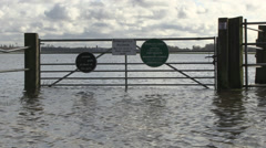 Gate and flooded water of river thames wolvercote common with port Stock Footage