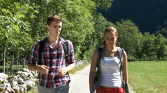 Close shot of wandering couple with travel bags Stock Footage