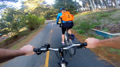 POV bike riding adventurous couple exercising together  USA Stock Footage