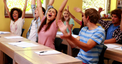 Students sitting in classroom and cheering Stock Footage
