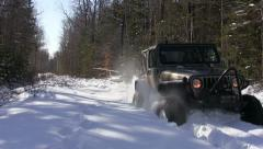 Jeep Spinning its Tires in Deep Snow in Nova Scotia Stock Footage