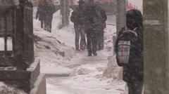 Pedestrians slip fall on ice sidewalk in winter storm in Waterloo Canada Stock Footage