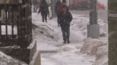 Pedestrians slip and fall on ice and snow Stock Footage
