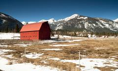 Red barn endures mountain winter wallowa whitman national forest Stock Photos