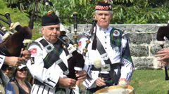 Stock Video Footage of Bermuda Pipe Band Bagpiper And Drummer