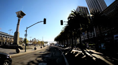 POV road journey tree lined road built structure suburban San Francisco USA Stock Footage