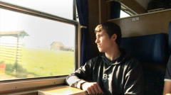 Boy stares out of the window from an old moving train Stock Footage