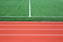 Soccer green field artificial grass with white lines Stock Photos