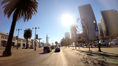 POV driving city suburbs road vehicle sun flare traffic San Francisco USA Stock Footage