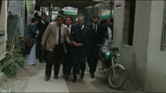 Wounded Lawyer being evacuated from scene of Terrorist Attack in Pakistan Stock Footage