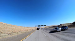 POV driving rural environment built structure Freeway vehicle USA - stock footage