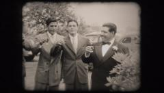 Young men toasting glass drinking  (vintage old home movie film) Stock Footage