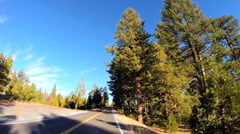 POV driving mountain Pass blue sky Sonora Pass Sierra Nevada, USA Stock Footage