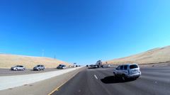 POV driving rural environment built structure Freeway vehicle USA Stock Footage
