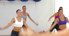 Aerobics instructor leading a happy class of women - stock footage